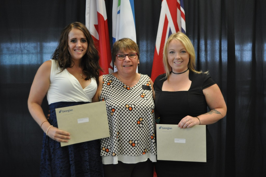 Melissa MacDonald and Patricia Flowers receiving the Christopher McLean Memorial Award