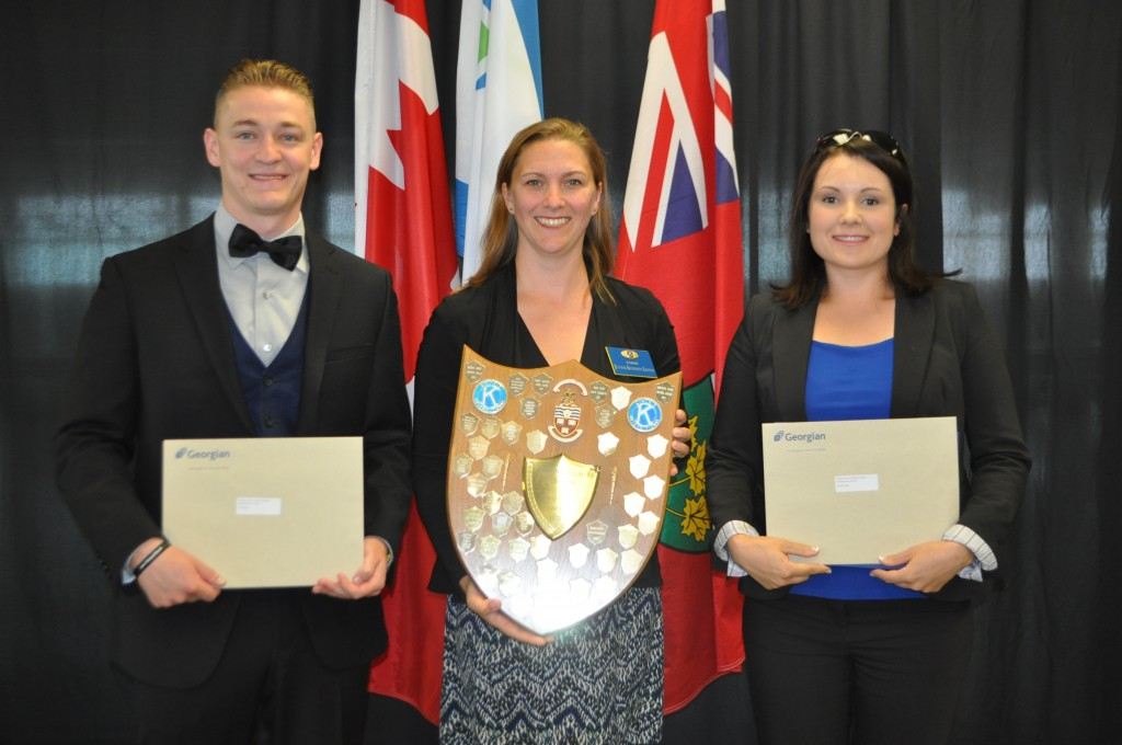 Kyle Bond and Janice Clark receiving the Kiwanis Club of Barrie Golden Anniversary Award