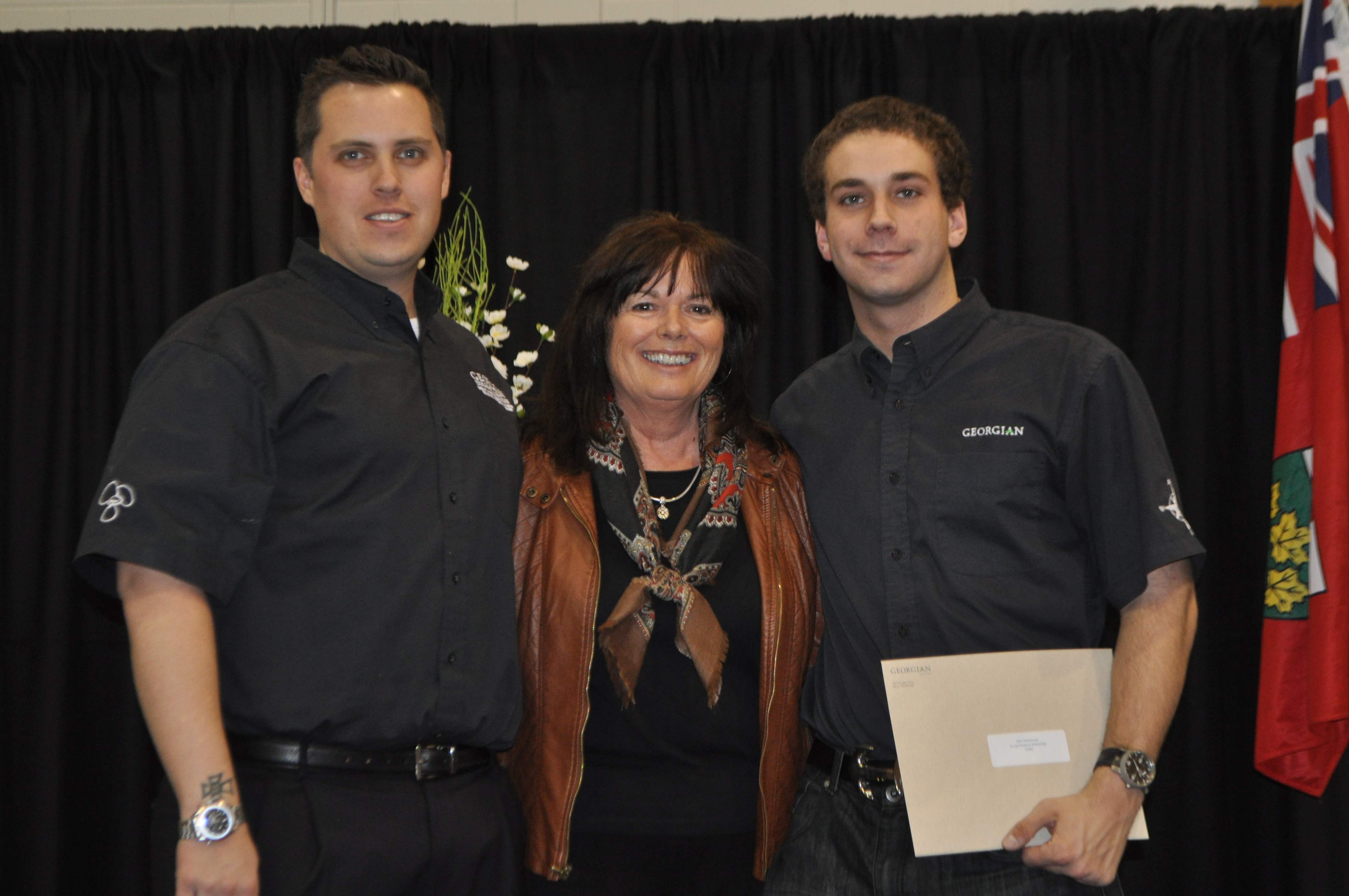J. Davenport and J. Hutchinson receiving the Co-op Entrance Scholarship