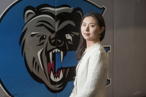 Davina, in front of the Grizzlies logo