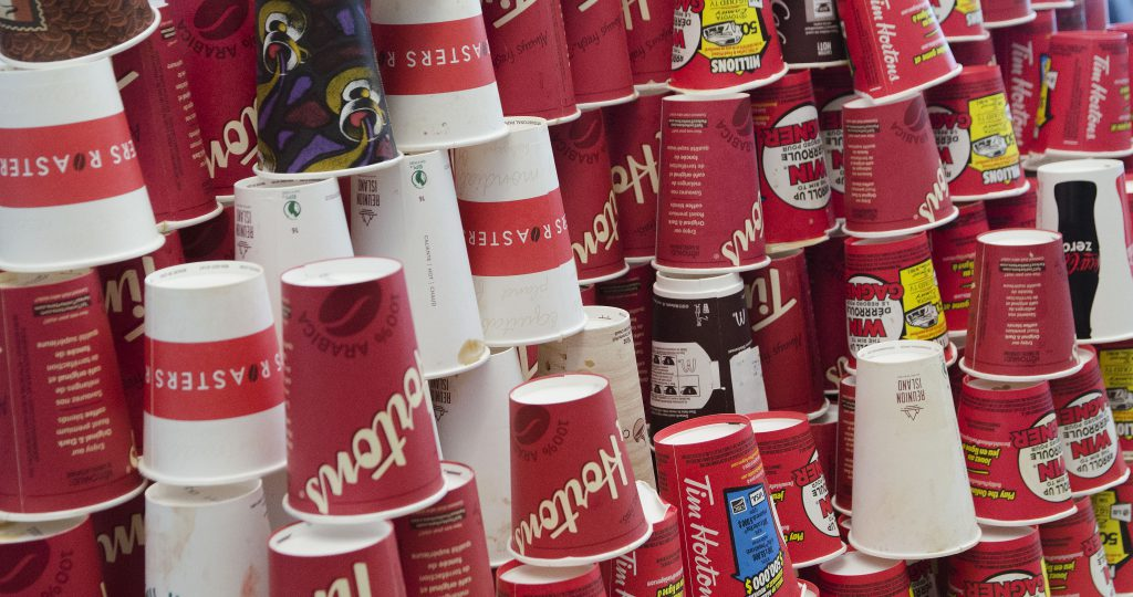 A giant tower of paper coffee cups