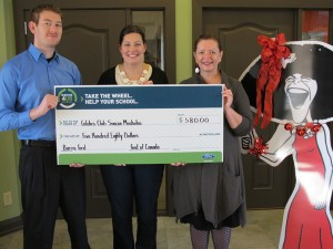 From left to right: Rob Scott, Director of Training and Recruitment (2013 Auto Show Student Committee), presents a cheque to Gilda's club staff members Katherine Speirs, Development and Fundraising Co-ordinator, and Deborah Loosemore, Managing Director.