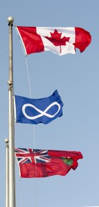 The three flags at the Barrie Cenotaph - Canadian, Métis and Ontario