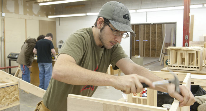 Carpentry student working on a project