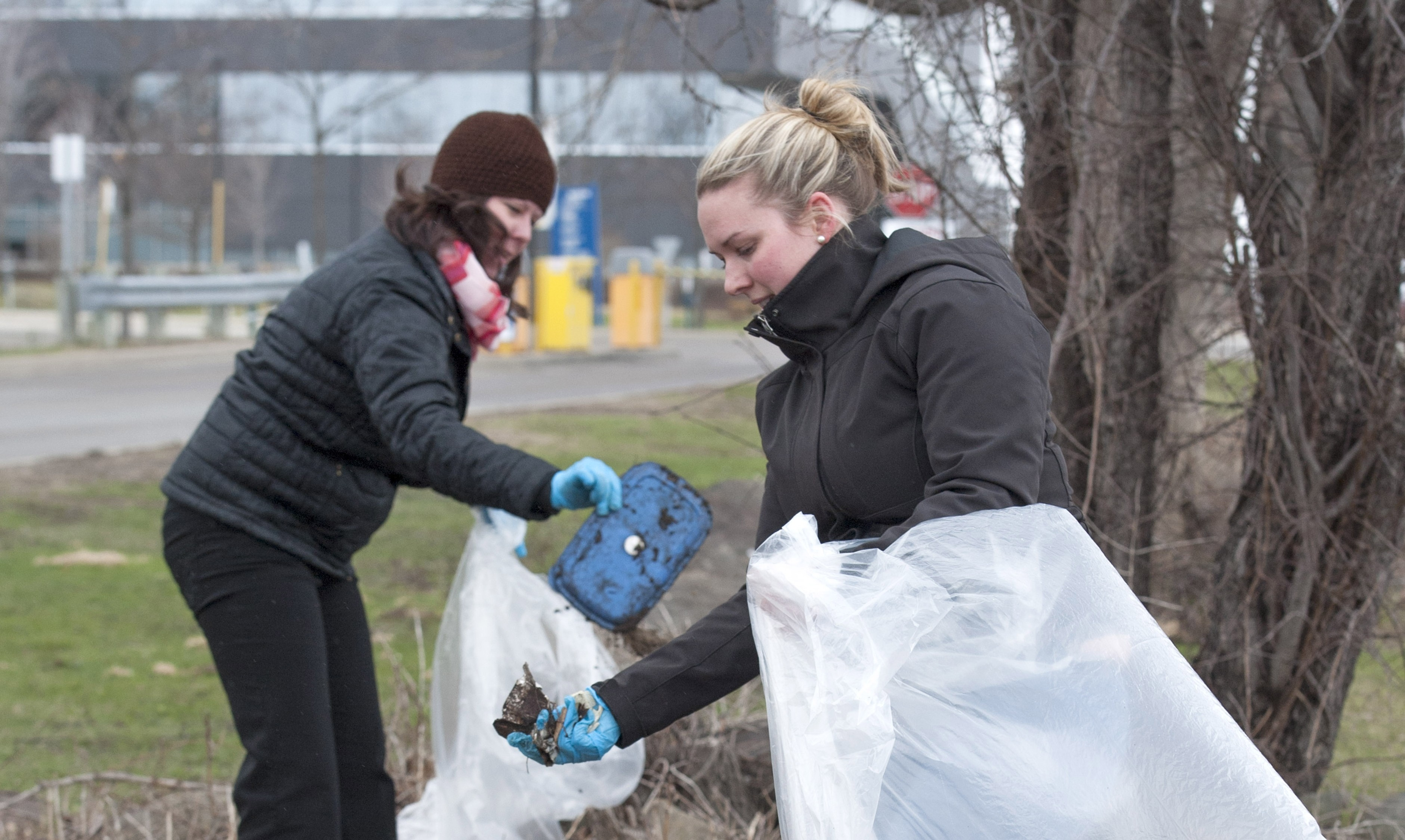 Sara Tuck, left, and Angela Bertram pick up garbage at the Barrie Campus as part of Georgian College's two-hour campus cleanup on Earth Day, April 22, 2015. More than 100 people braved the cold and sleet to tidy up the college's Barrie, Orillia, Owen Sound and Midland campuses, collecting over 20 bags of garbage. (Handout-Georgian College/Doug Crawford)