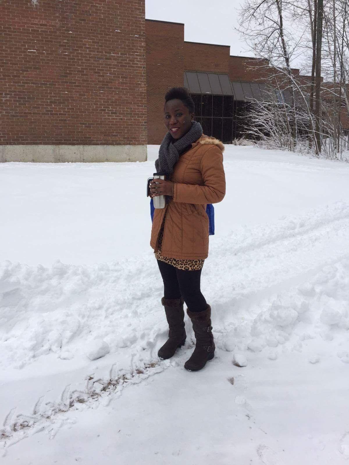 A woman walks outside the Orillia Campus in the snow