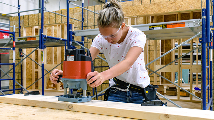 Female-construction-trades-pre-apprenticeship-student-works-on-a-project-in-the-shop-space