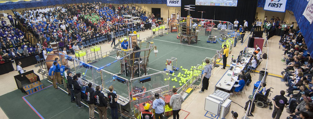Dozens of high school students compete in a closed course with their custom-built robots while spectators watch at the FIRST Robotics competition at Georgian Colllege