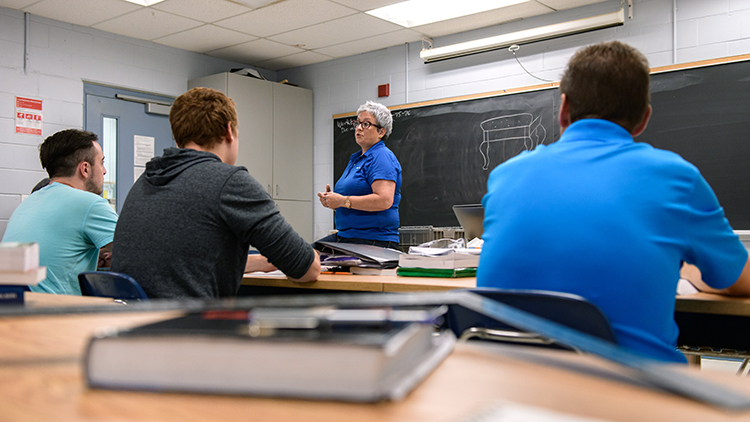 Georgian-College-carpentry-instructor-and-coordinator-Lynn-MacKinlay-teaches-students-at-the-front-of-the-class