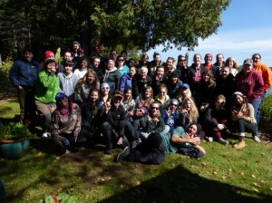 Large group of students and staff posing under a tree in Algonquin