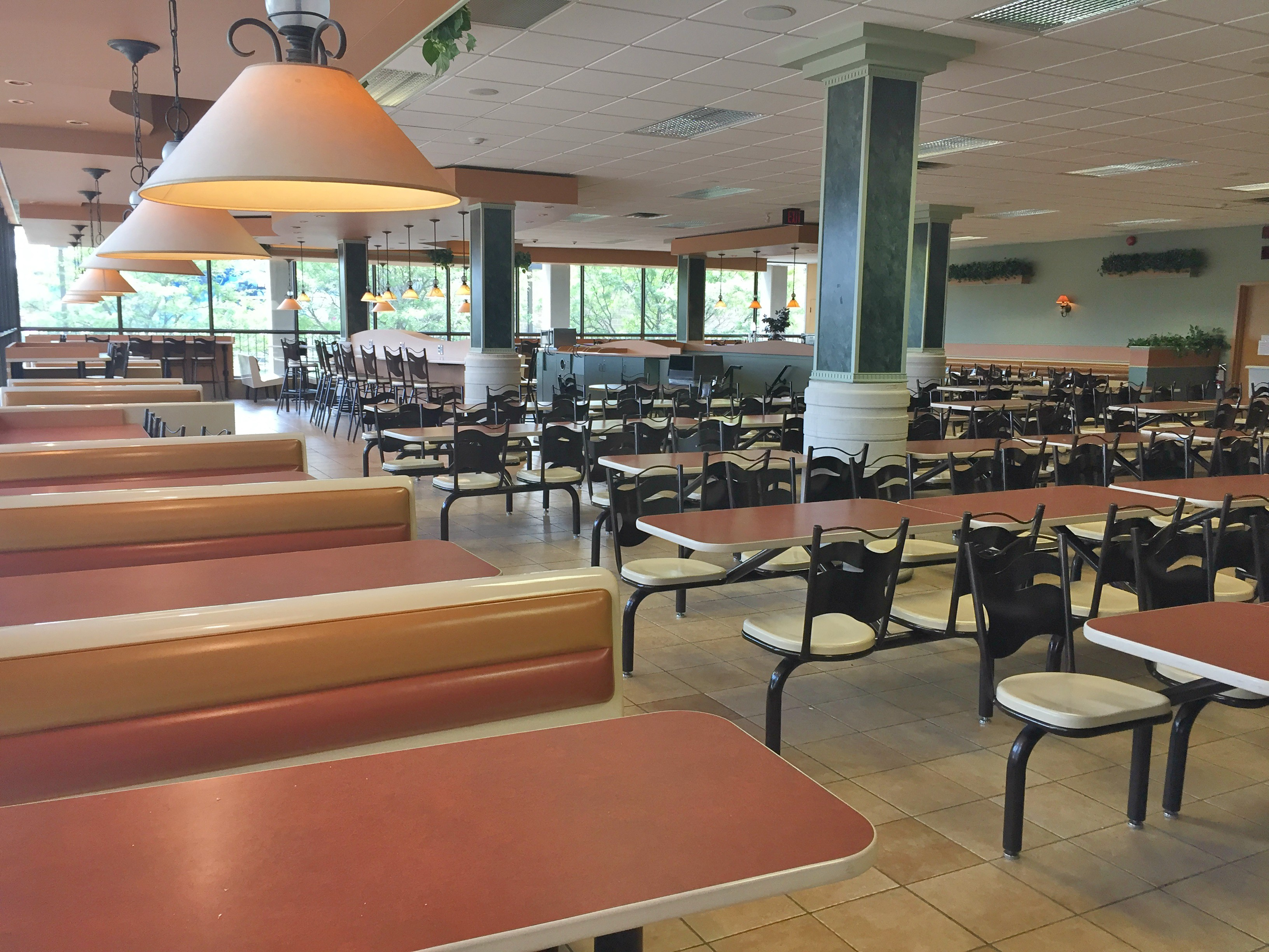 Marketplace cafeteria with fixed seating and booths