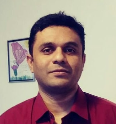 Javeed with a red shirt and white background