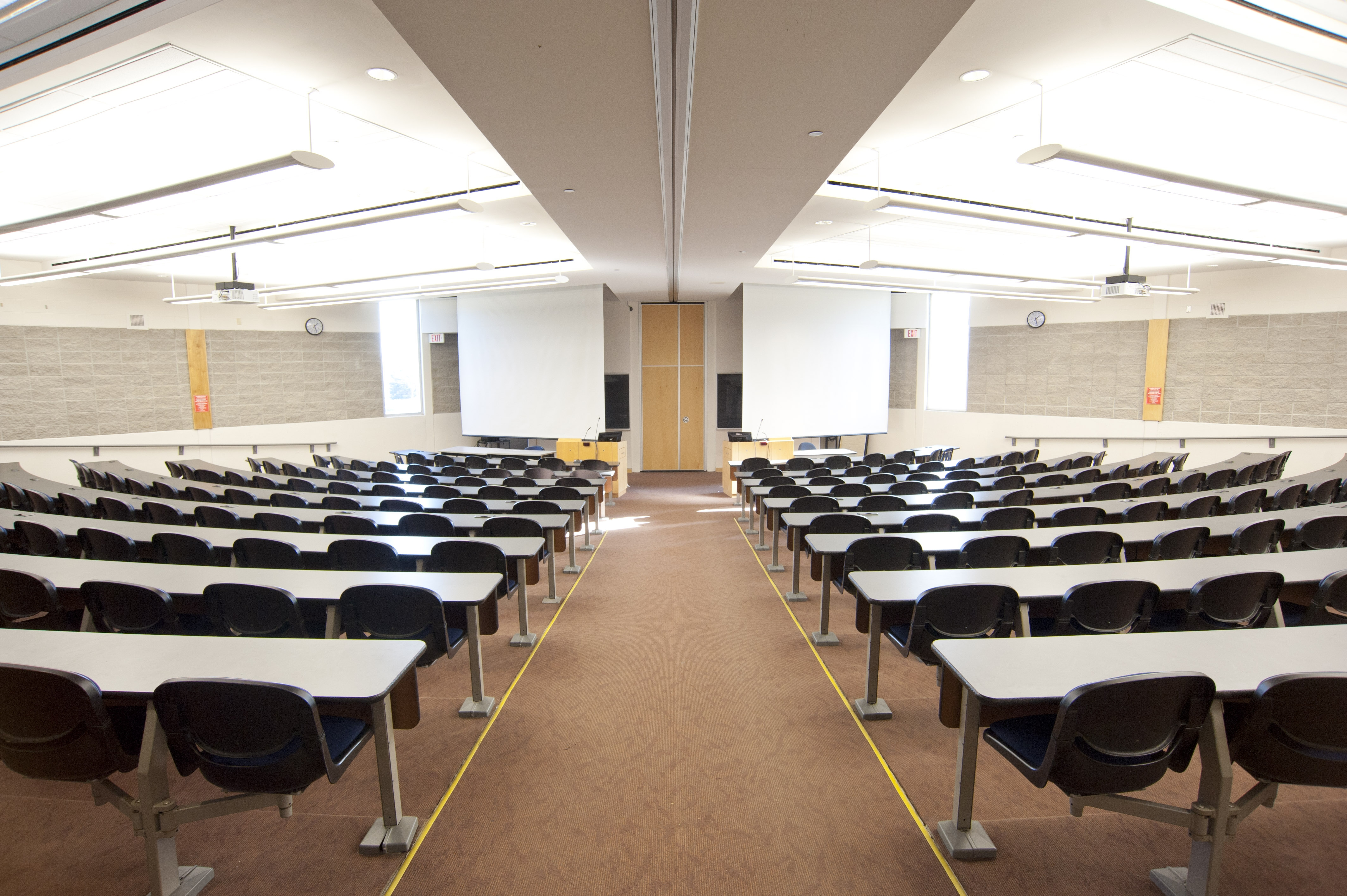 A double-sided lecture hall with two screens