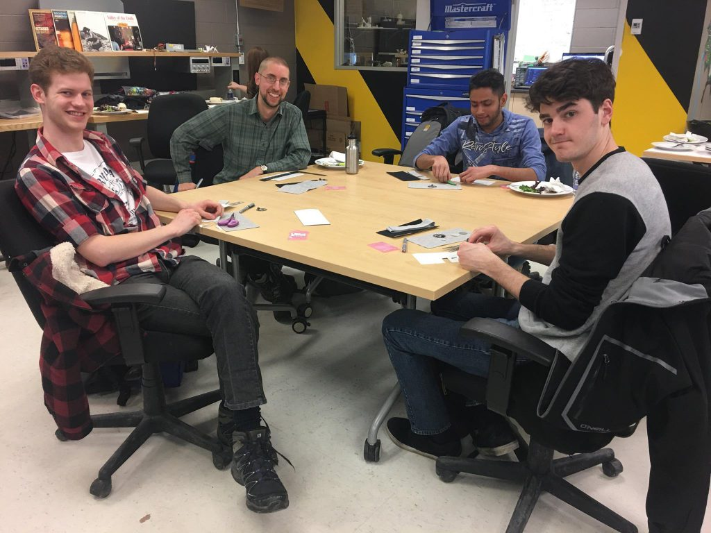 Students making items around a table