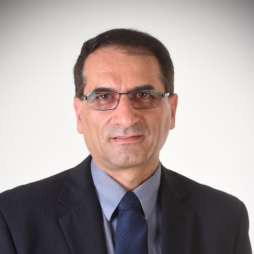 Mohammadreza with glasses in a white background