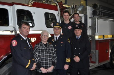 Midland Fire Chief Kevin Foster with Mary O'Farrell-Bowers, Dean, School of Public Safety and Emergency Services and a group of students