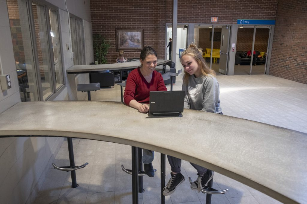 2 female students working on a laptop at the Owen Sound Campus