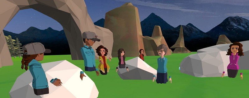 Students engaging in VR technology world; 7 avatars gathered in open space with rocks, bolders and green grass
