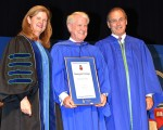 W. R. (Bill) Van Wyck, centre, receives the Georgian College Board of Governors' Honorary Bachelor of Applied Studies degree during convocation ceremonies at the Owen Sound Campus June 16. Presenting the degree are Georgian College President and CEO MaryLynn West-Moynes, left, and Board Vice Chair Jim Bertram.