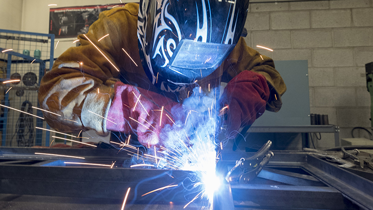 Welding student works on project in Skilled Trades Centre