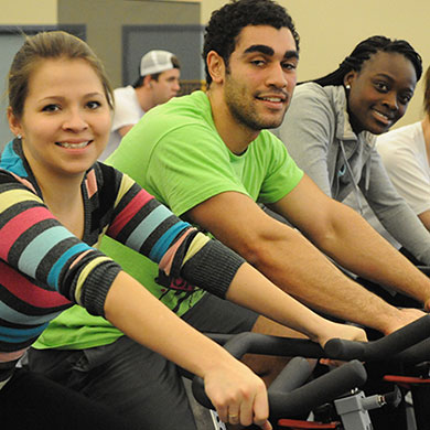 Students riding exercise equipment