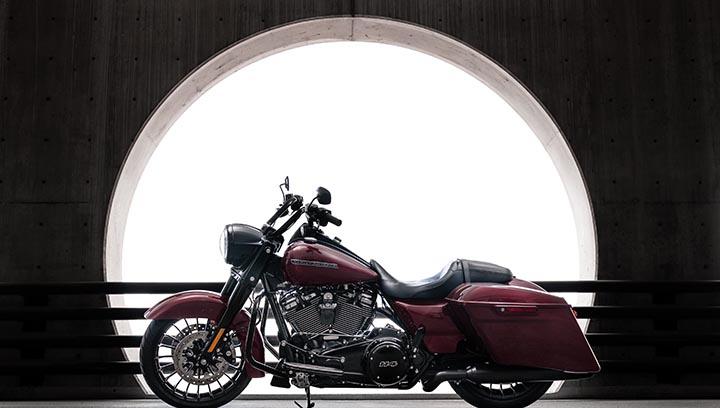 Motorcycle in front of a circle window