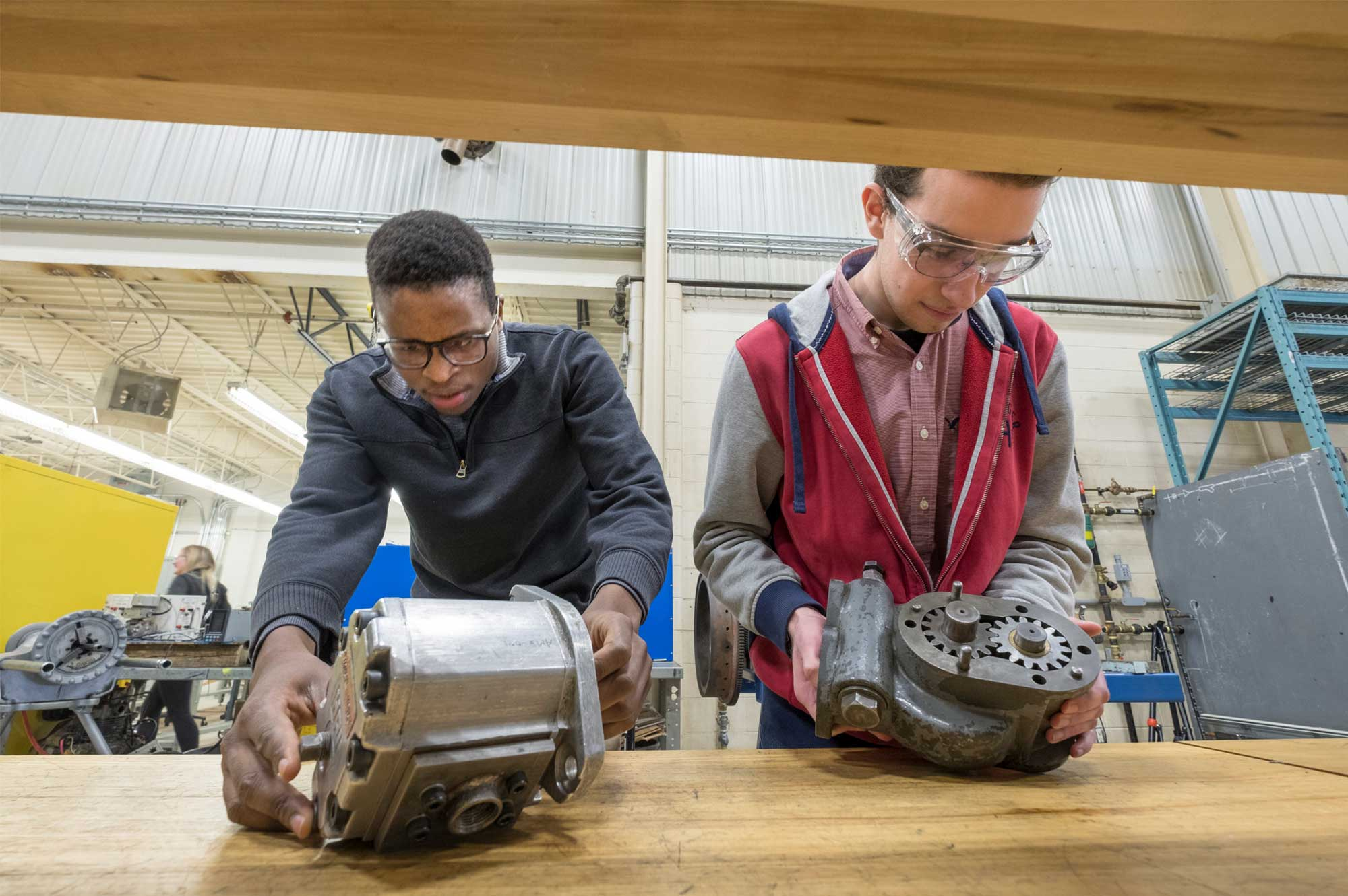 two male power engineering students at Georgian College working on machinery