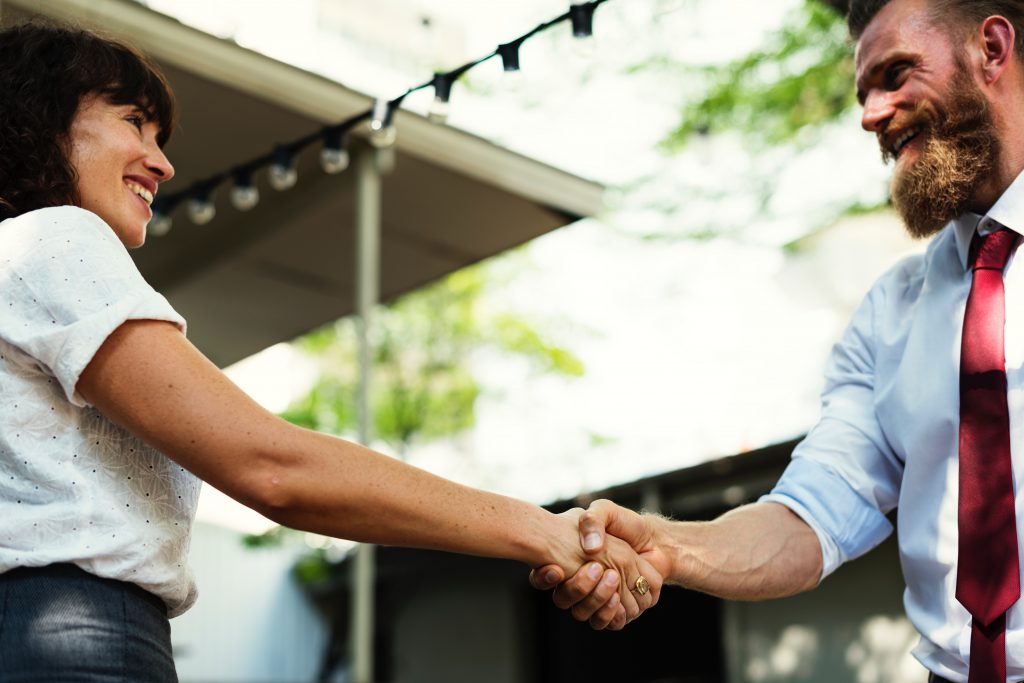 Handshake between woman and man in business attire