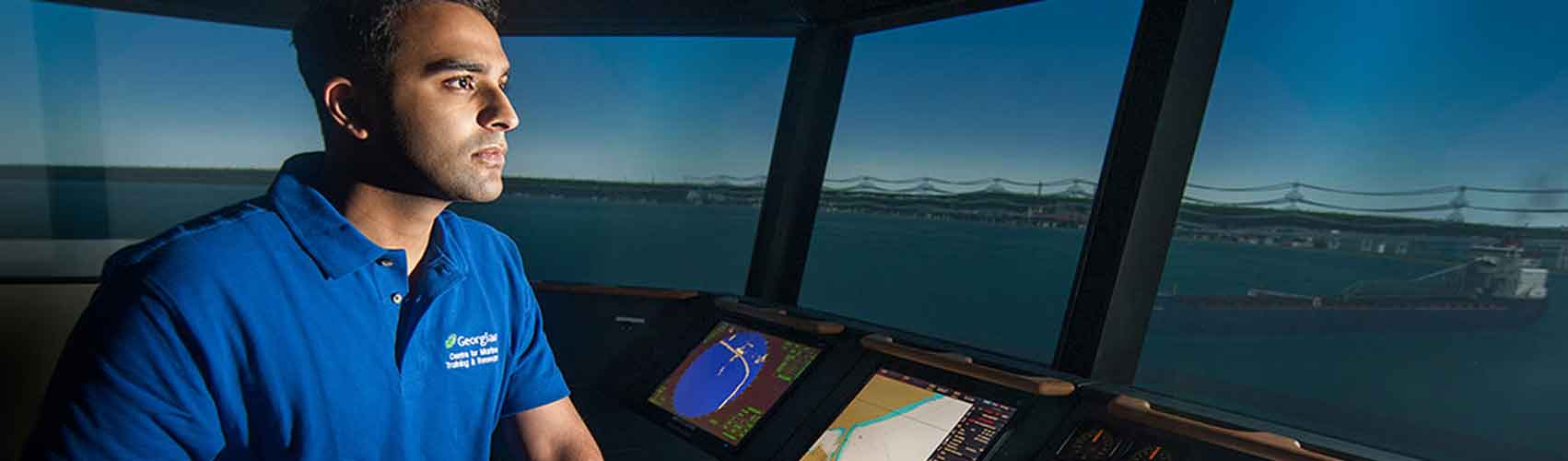 Marine student on the bridge of a marine ship simulator